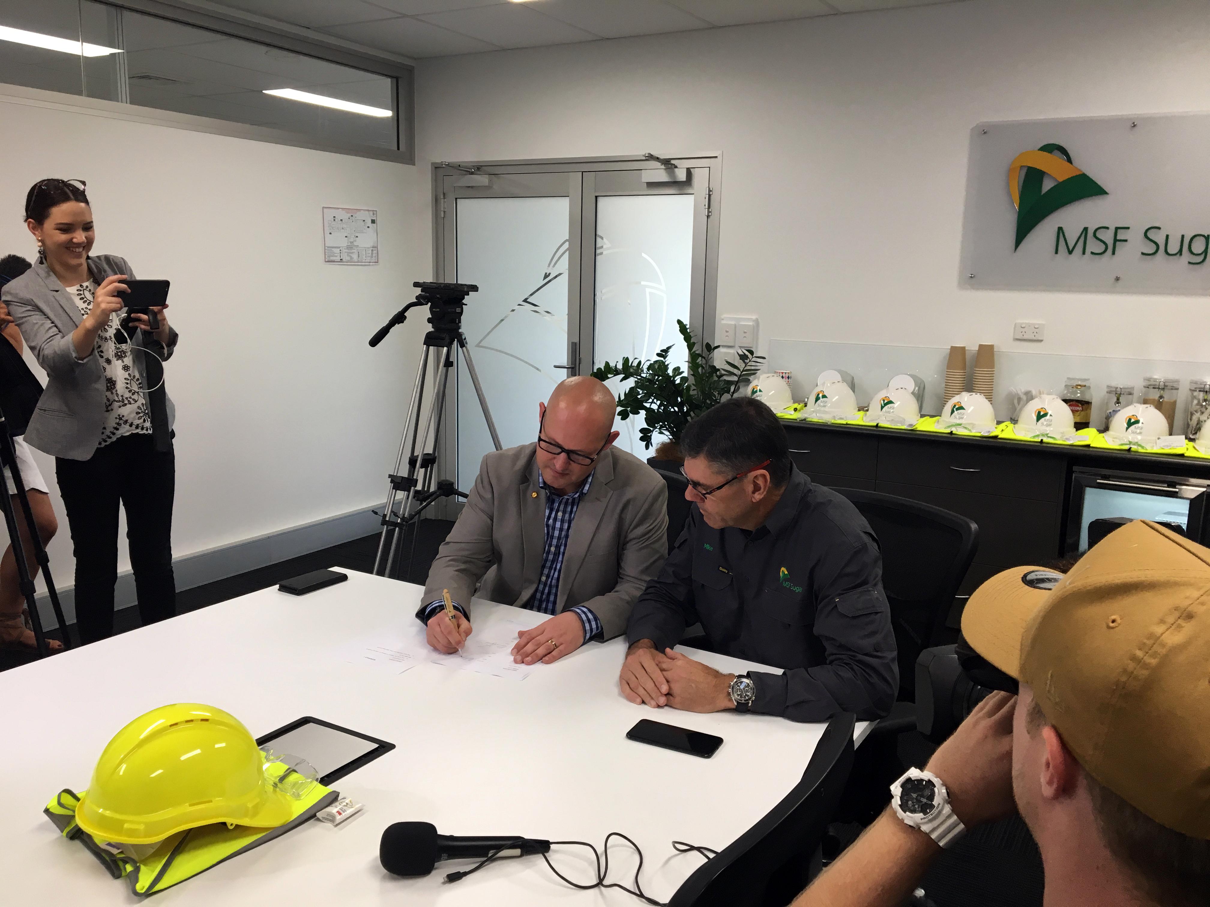Queensland Treasurer Curtis Pitt Signing the MOU